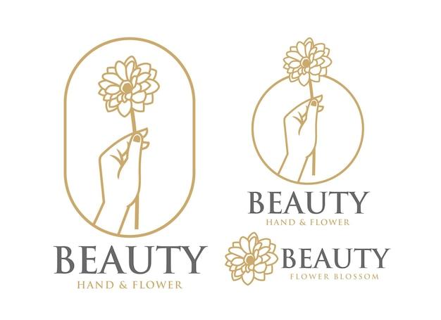 꽃의 아름다움 로고 템플릿을 들고 여성의 손
