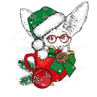 Лисица фенек в рождественской чашке