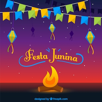 Festa junina background with campfire and pennants