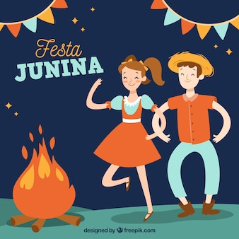 Festa junina background with people dancing around a campfire