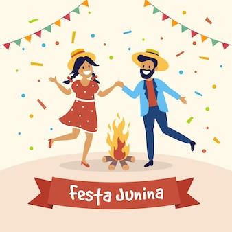 Festa junina people dancing around the fire