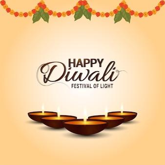 The festival of light happy diwali celebration greeting card with garland flower and diwali diya