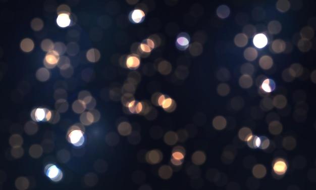 カラフルなライトとボケ味のまぶしさを飛んで輝く粒子のほこりとお祝いの青い明るい背景