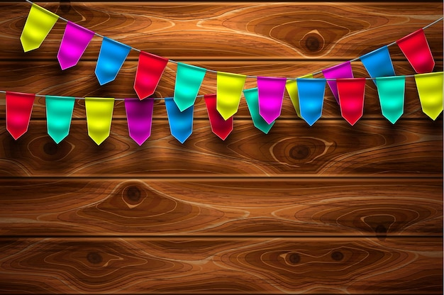 Festive bunting flags on wooden texture background
