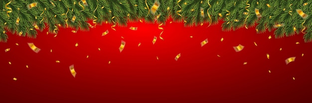 紙吹雪とクリスマスファーツリーの枝とお祝いのクリスマスバナー。