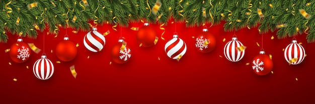 Festive christmas banner with fir-tree branches with confetti and xmas red balls.