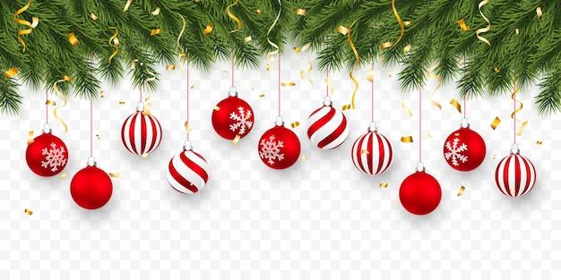 Праздничный фон рождество или новый год. рождественские еловые ветки с конфетти и рождественскими красными шарами. фон праздника.