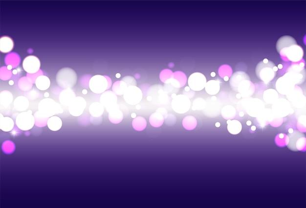 青い背景にお祝いの焦点ぼけライト。輝きのある抽象的な背景。