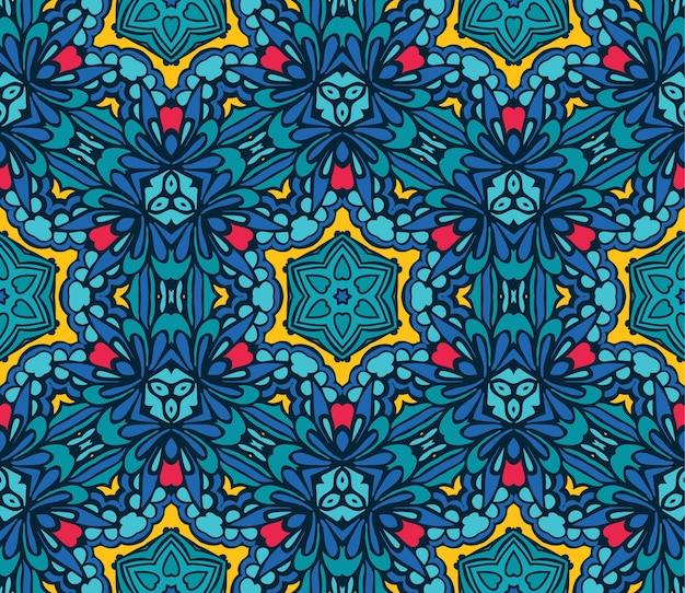 お祝いの幾何学的な万華鏡のようなシームレスなパターン民族部族の背景