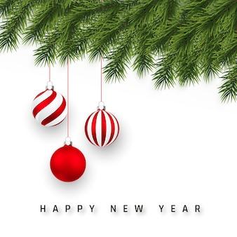お祭りの新年の背景。クリスマスツリーの枝とクリスマスの赤いボール。
