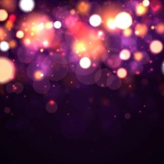Праздничный фиолетовый и золотой светящийся фон с красочными огнями боке. концепция поздравительных открыток. волшебный праздник плакат, баннер. ночные яркие золотые искры