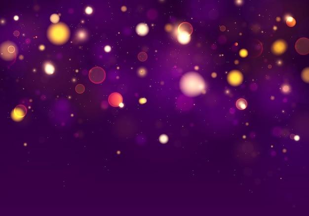カラフルな光のボケ味とお祝いの紫と金色の明るい背景。