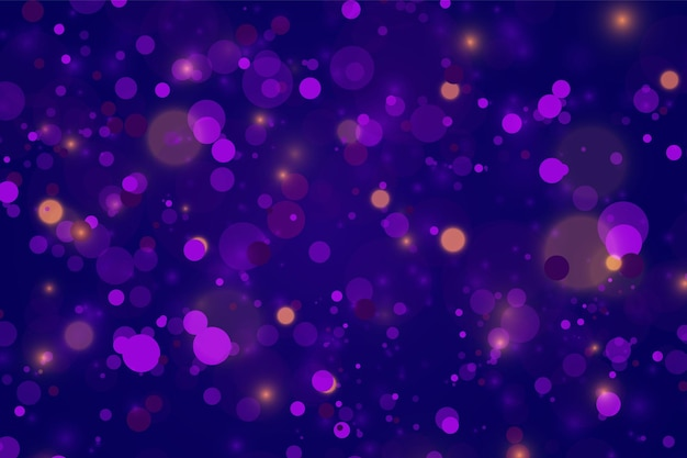 Festive purple and golden luminous background with colorful lights bokeh. christmas concept xmas greeting card. magic holiday poster, banner. night bright gold sparkles light abstract