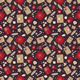 Праздничный бесшовный образец с рождественскими подарками, конфетами и рождественскими украшениями Premium векторы
