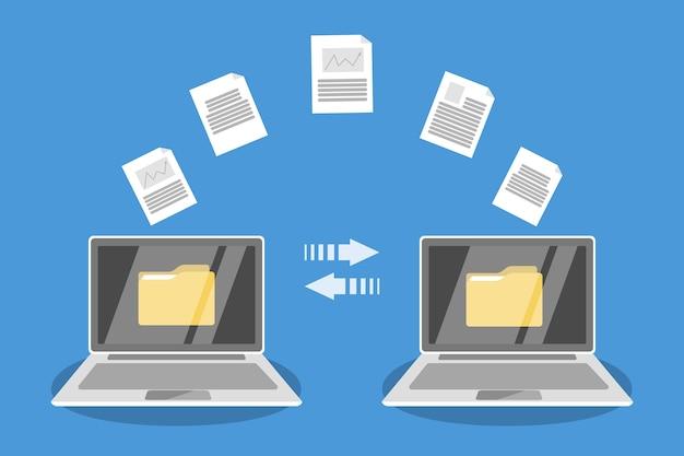ラップトップコンピュータ間のファイル転送。インターネット経由でファイルをコピーし、データを交換し、ドキュメントを転送します。現代の技術コンセプト。図