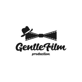フィルムストリップ、派手な帽子をかぶった蝶ネクタイを形成するフィルムロール。ヴィンテージレトロ映画フィルムシネマロゴデザインテンプレート
