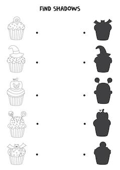 할로윈 컵 케이크의 그림자를 찾으십시오. 흑백 워크 시트. 아이들을위한 교육 논리 게임.