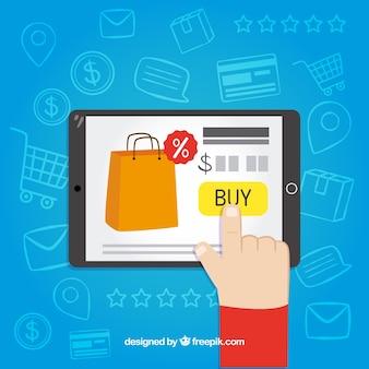 Палец, покупающий онлайн с планшетом