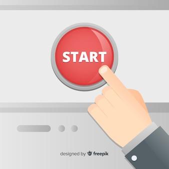 赤いスタートボタンを押す指