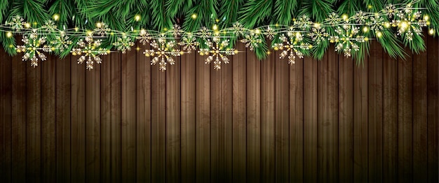 ネオンライトと木製のテクスチャに雪片とゴールデンガーランドのモミの枝