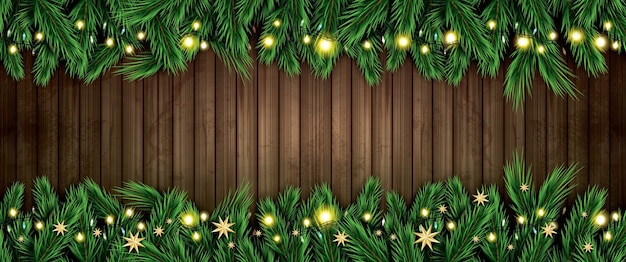 Fir branch with neon lights and golden stars on wooden background. merry christmas and happy new year.