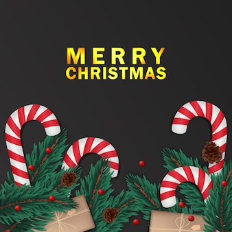 Fir leaves with candy cane and present box black christmas greeting card