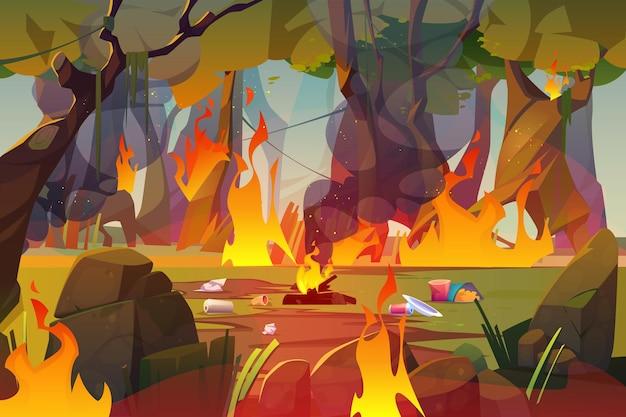 성난 불길과 쓰레기로 숲에 오염 된 나무에 불