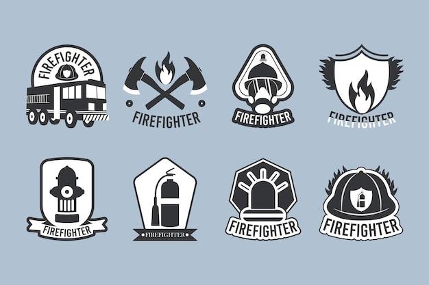 Набор значков пожарного на синем фоне
