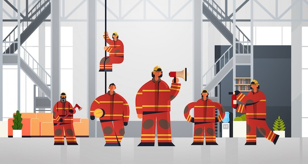 Firemen team standing together firefighters wearing uniform and helmet firefighting emergency service concept modern fire department interior flat horizontal full length