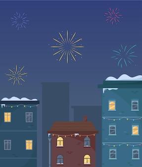 冬の夜空の花火冬の夜の新年の街並み