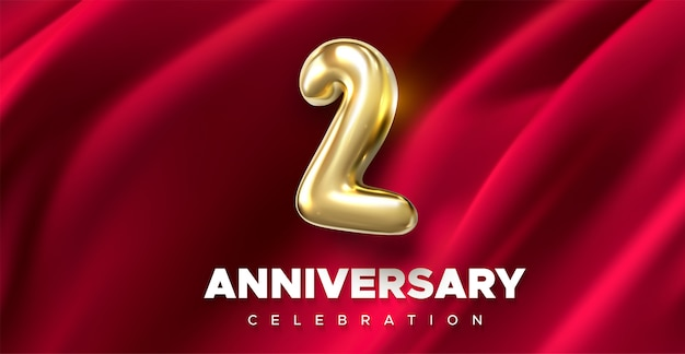 First anniversary celebration. golden number 2 on red draped textile background.