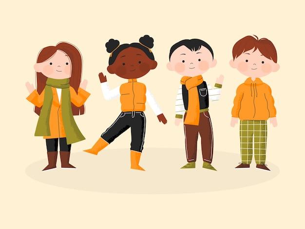 秋の初日。秋の服に立っているかわいい子供たち。幸せな生徒は秋に学校に戻ります。