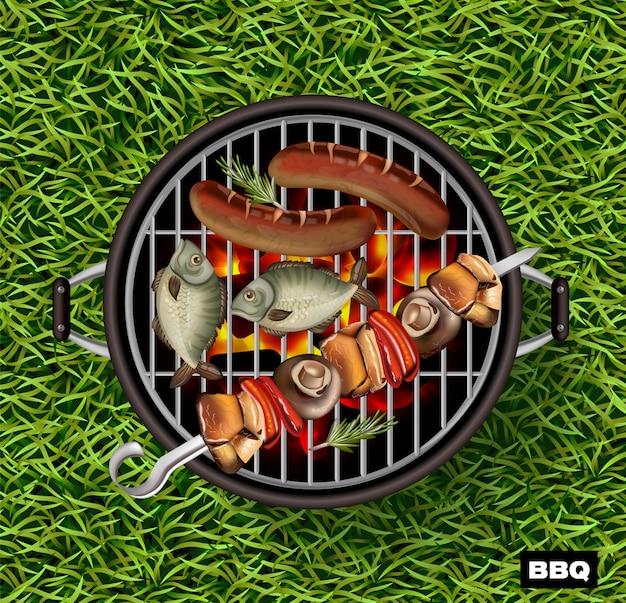 バーベキューグリルで魚やソーセージを調理する