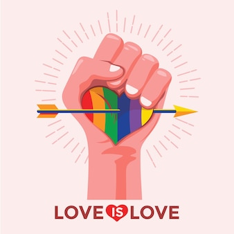 Fist holding a heart pride day concept