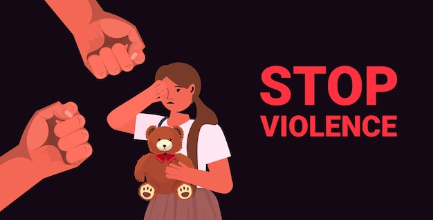 Fists over scared terrified child stop family violence aggression concept little girl crying portrait