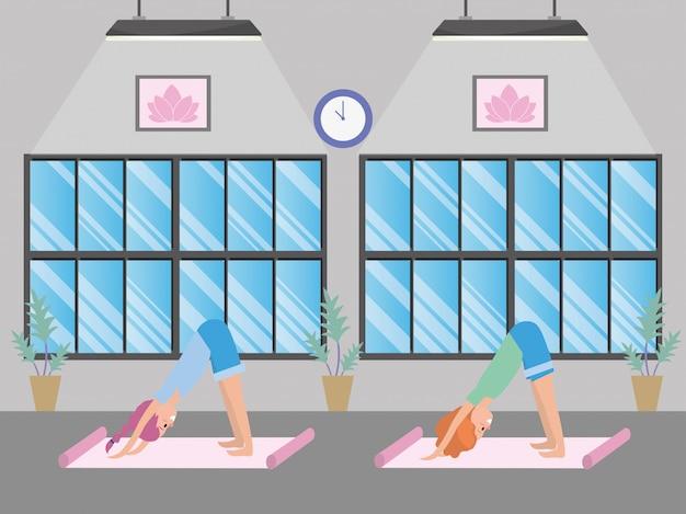 Fit women practicing yoga