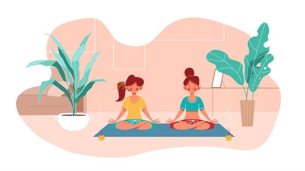 Фитнес дома. две девушки занимаются йогой в позе лотоса в комнате