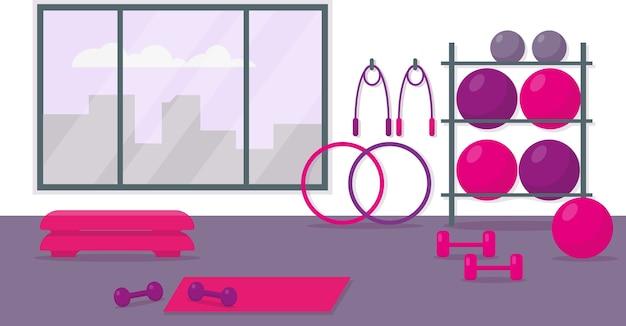 女性のトレーニングのためのフィットネスセンター。トレーニング機器を備えたジムのインテリア。