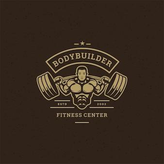 フィットネスジムのバッジまたはエンブレムベクトルイラストボディービルダーの男がtシャツやプリントスタンプの重いバーベルのシルエットを持ち上げます。レトロなタイポグラフィのロゴデザイン。