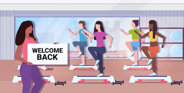 Fitness trainer holding welcome back sign board coronavirus quarantine is ending victory over covid-19
