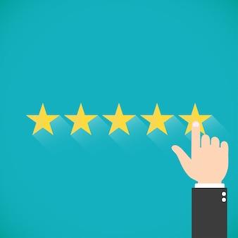 5 золотых звезд с иллюстрацией руки. палец нажимает на звезду. оценка для веб-сайтов