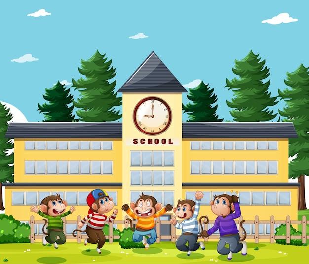 公園の遊び場のシーンでジャンプする5匹の小猿