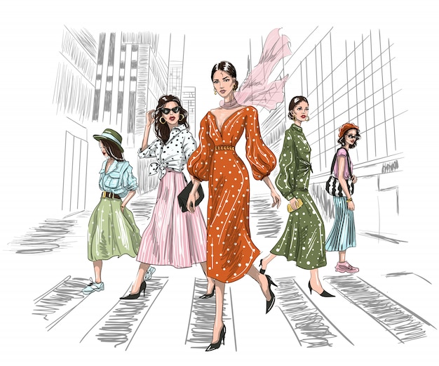Five women walking on a crosswalk in big city