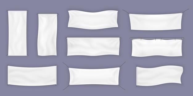 Флаговый баннер и тканевый плакат для рекламы. набор реалистичных уличных рекламных текстильных горизонтальных тканевых баннеров. шаблон готов для вашего текста и дизайна.