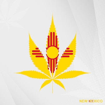 Flag of new mexico in marijuana leaf shape. the concept of legalization cannabis in new mexico.