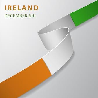 Флаг ирландии. 6 декабря. векторная иллюстрация. волнистая лента на сером фоне. день независимости. национальный символ. шаблон графического дизайна. Premium векторы