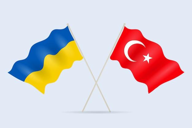 Флаг украины и турции вместе. символ дружбы и сотрудничества государств. иллюстрация.
