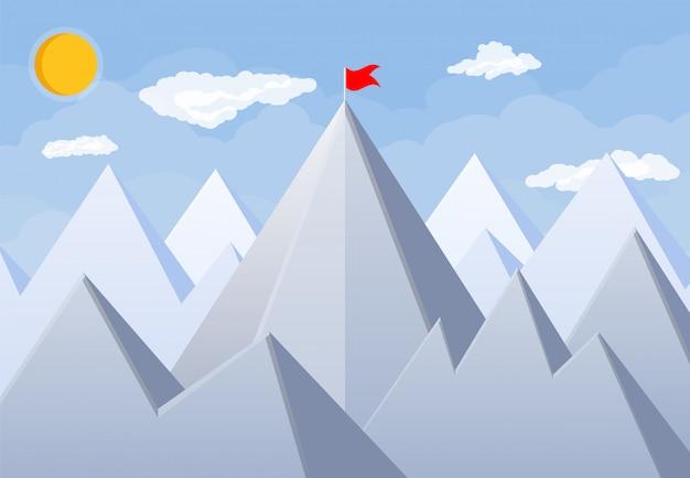 Flag on peak of mountain.