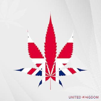 Flag of united kingdom in marijuana leaf shape concept of legalization cannabis