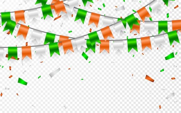 ガーランドに聖パトリックの日にフラグを立てます。旗の花輪とパーティーの背景。オレンジホワイトグリーンの旗とホイル紙吹雪の花輪。